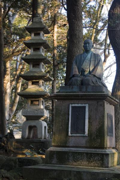Statue and stone pagoda in the Narita-san park | Narita-san Shinsho-ji temple | Japan