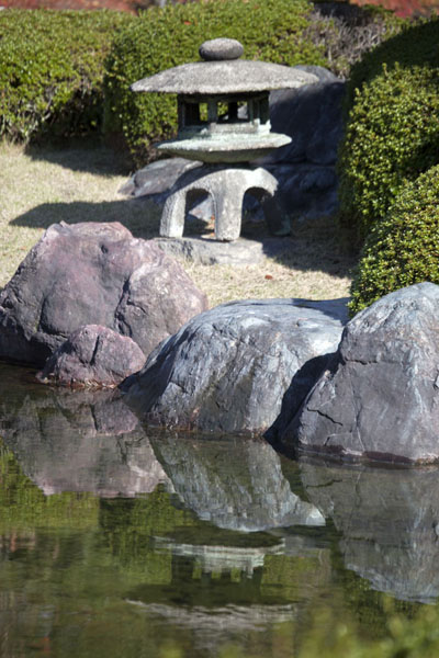 Stone lantern at a pond of Seiryu-en garden | Nijo Castle | Japan