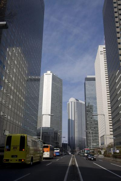 Picture of Nishi Shinjuku architecture (Japan): Skyscrapers and traffic on a street in Nishi Shinjuku