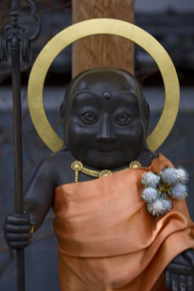 Close-up of Buddhist statue outside the temple | Zenko-ji Temple | Japan