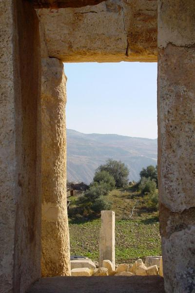 Peering through a window at Qasr al-Abd | Wadi Seer | Jordan