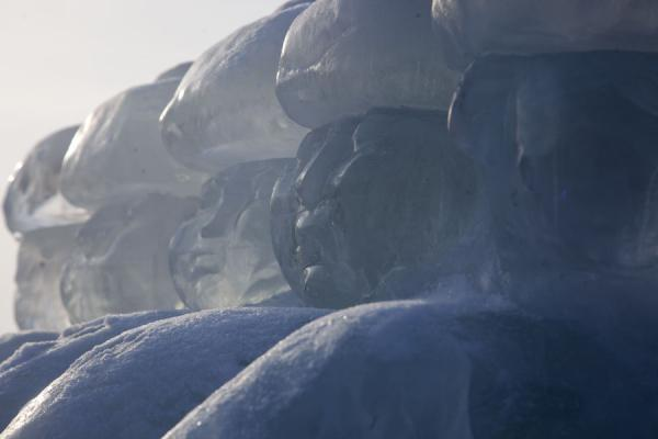 Row of icy persons carved out of a block of ice in Astana City Park | Astana Ice Sculptures | Kazakhstan