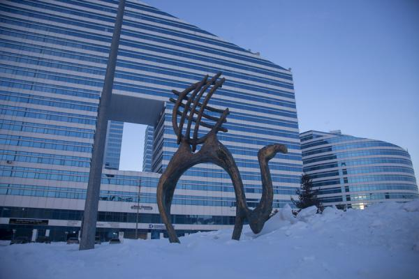 Camel with a shanyrak on top and modern architecture in the background | Astana modern architecture | Kazakhstan