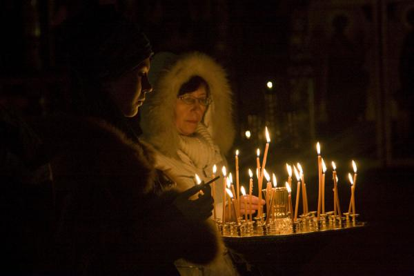 Orthodox women lighting candles | Holy Ascension Cathedral | Kazakhstan