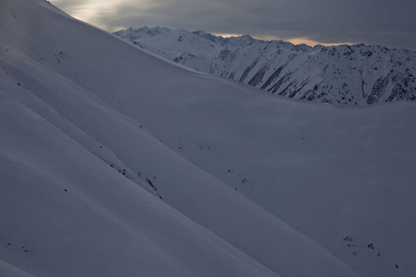 Late afternoon on the snowy slopes of the Tian Shan mountains | Furmanovka hiking | Kazakhstan