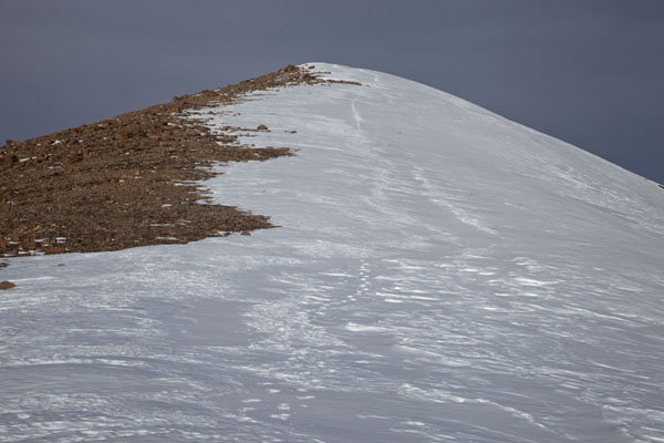 Looking up a ridge with snow and rocks | Furmanovka hiking | Kazakhstan
