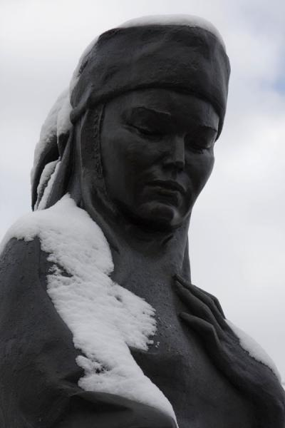 Detail of sculpture at the Monument of Independence: head of woman covered by snow | Independence Monument | Kazakhstan