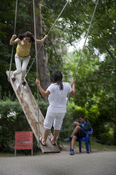 Two women having fun in the Altybakan swing on top of Kök Töbe | Kök Töbe Hill | 哈萨克斯坦
