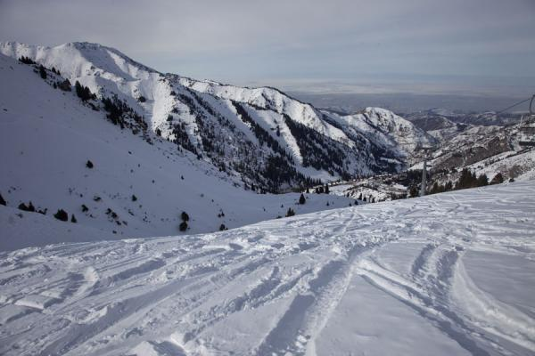 Looking down one of the black ski slopes towards the city of Almaty | Shymbulak skiing | Kazakhstan