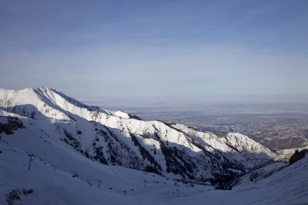 Picture of Shymbulak skiing (Kazakhstan): The main Asiada slope in the foreground, and a view of the city of Almaty in the background