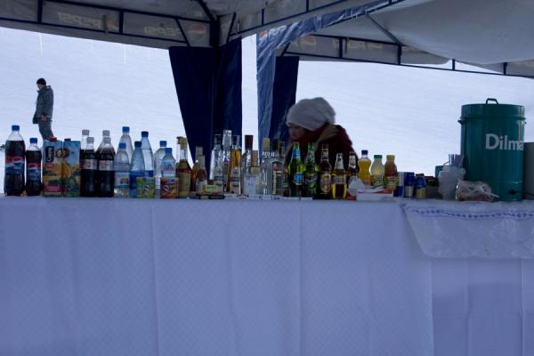 Woman selling drinks and snacks right next to the ski slope | Tabagan Skiing | Kazakhstan