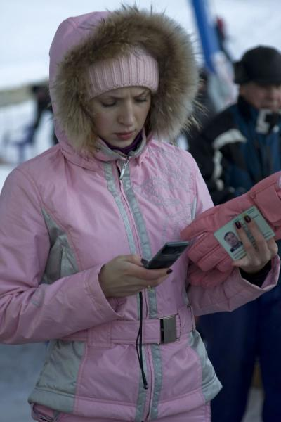 Kazakh skier in pink dress getting ready to call | Tabagan Skiing | Kazakhstan