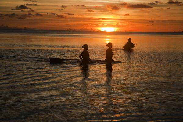 Picture of Abaiang Atoll (Kiribati): Walking the seas for a catch at sunset