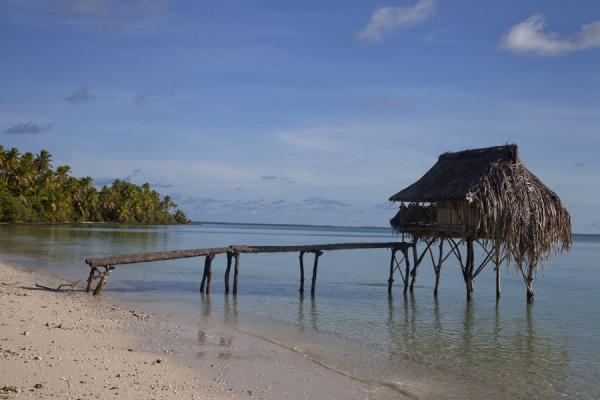 Picture of Abaiang Atoll (Kiribati): House on stilts jutting out into the lagoon of Abaiang atoll