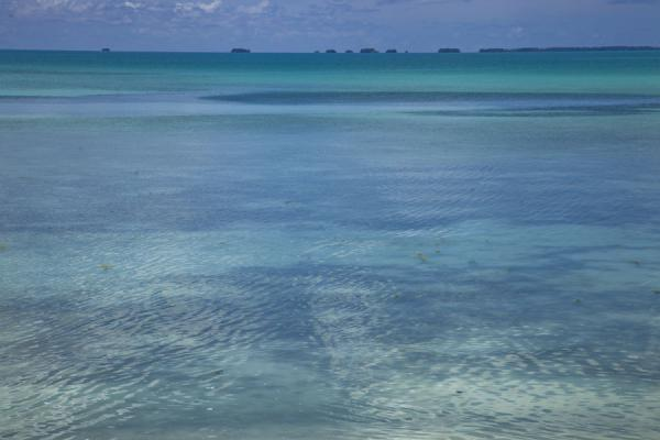 Picture of Abaiang Atoll (Kiribati): Blue and green colours of the lagoon with the islets of the western side of the atoll in the distance