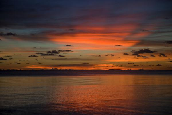 Picture of Abaiang Atoll (Kiribati): The sun setting the skies over Abaiang atoll on fire