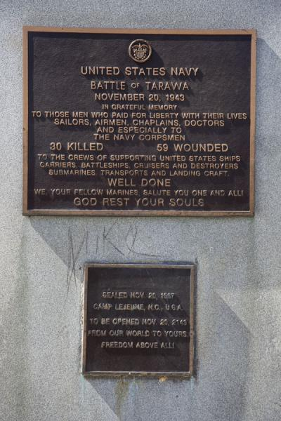 Plaque on the memorial column erected for the US soldiers with capsule to be opened in 2043 | Battle of Tarawa relics | Kiribati