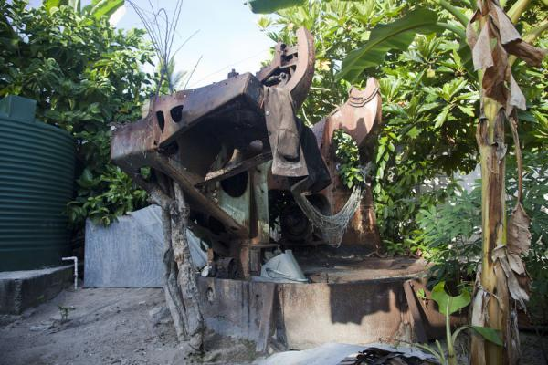 Picture of Gun rusting away in someone's backyard in BetioBetio - Kiribati