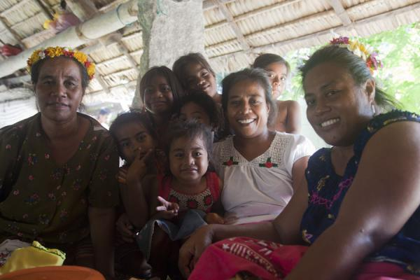 Women and girls in a maneaba during a women's celebration | Gente I-Kiribati | Kiribati