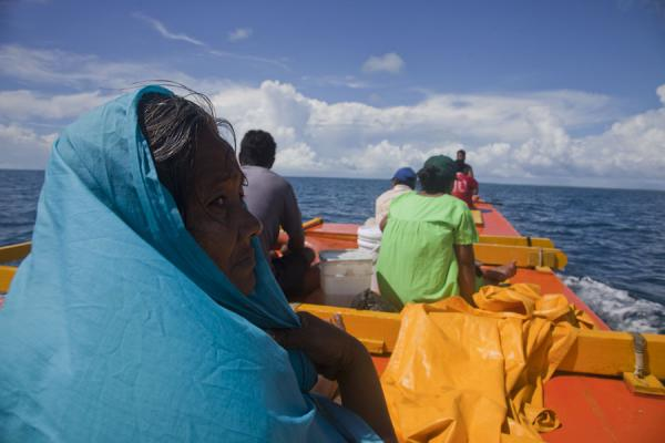 Picture of I-Kiribati people on an outrigger canoe between South and North TarawaKiribati - Kiribati