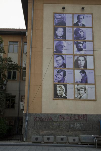 Picture of Famous Kosovar authors, actors, and others on a wall in downtown Pristina