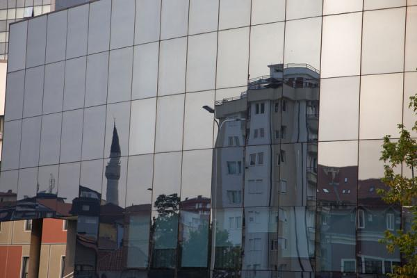 The skyline of Pristina mirrored in one of the shiny new buildings | Pristina | Kosovo