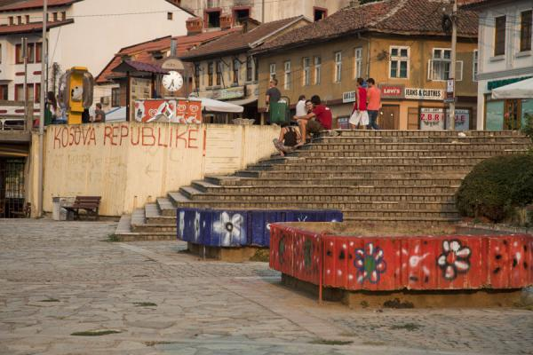 Picture of Promenade close to the river with traditional houses and graffiti on the walls - Kosovo - Europe