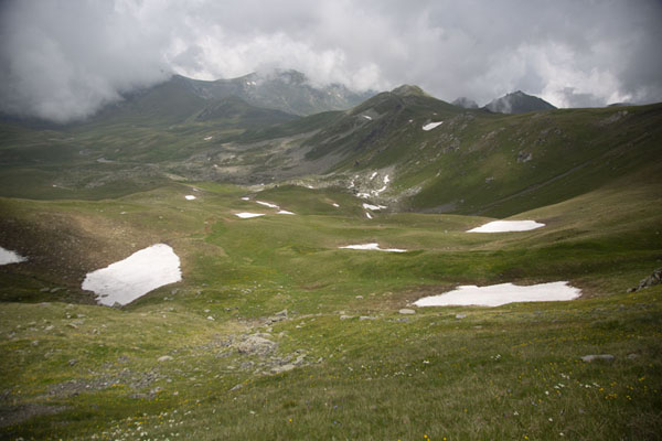 The upper parts of the Šar mountains with grass and snow | Rudoka e Madhe Peak | Kosovo