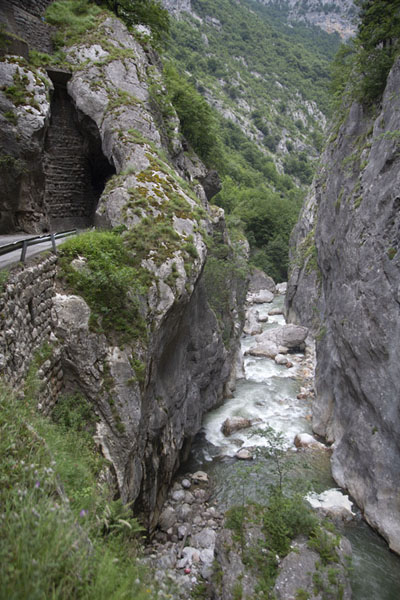 Narrow section of Rugova canyon with a tunnel in the road and Peć Bistrica river below | Canyon de Rugova | Kosovo