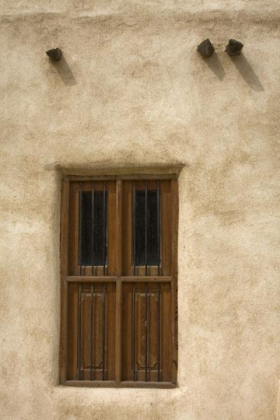 Wooden window shutter and beams in adobe wall of Beit Khalid | Sculpture Park | Kuwait