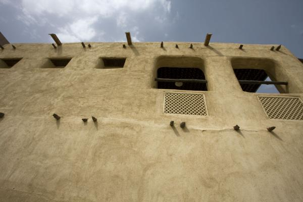 Picture of Looking up the wall of Beit Khalid with wooden beams holding the structure together