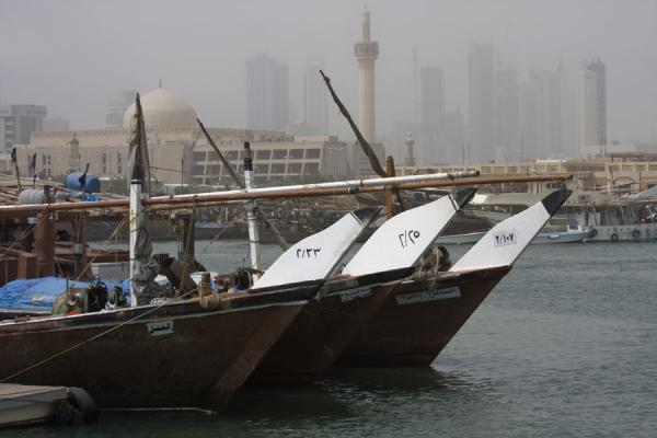 Bows of fishing-boats docked at the fish suq of Kuwait | Koeweit Vismarkt | Koeweit