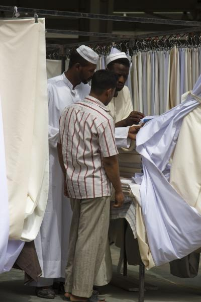Kuwaiti men looking at cloth at the Friday Suq | Kuwait Friday Suq | Koeweit