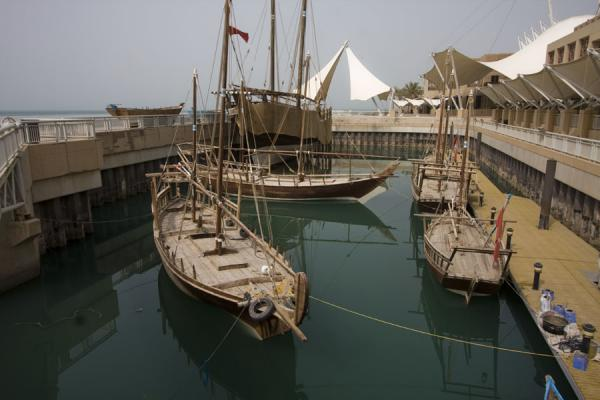 Foto van Several traditional boats moored in the small harbour outside Scientific CenterScientific Center - Koeweit