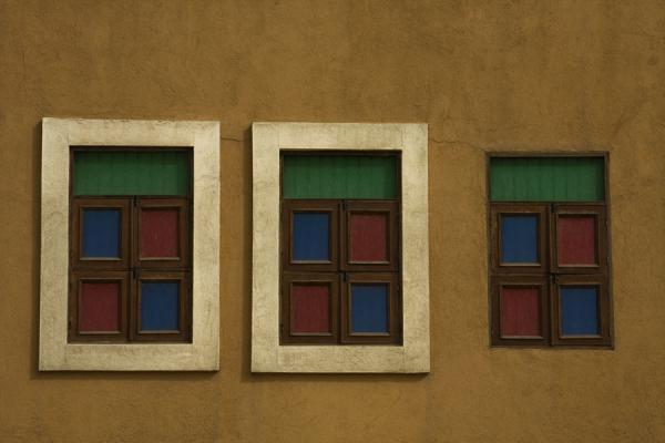 Picture of Old Kuwait (Kuwait): Green, blue, and red windows in an old house in Kuwait