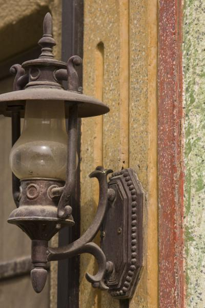Old lantern on the coloured wall of an old house in Kuwait | Old Kuwait | Kuwait