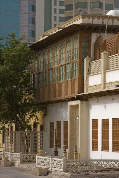 Row of old houses in Kuwait with modern buildings in the background | Old Kuwait | Kuwait
