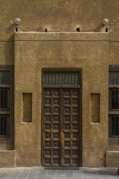 Picture of Old Kuwait (Kuwait): Wooden door standing out in an old house in Kuwait