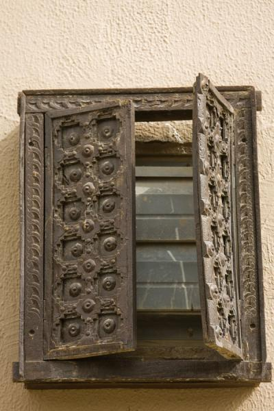Picture of Half open wooden window shutter in old house in Kuwait
