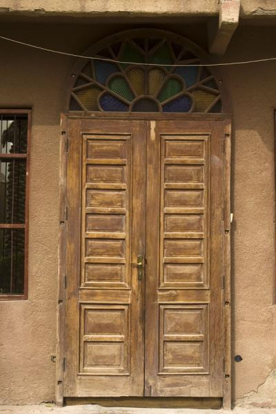 Picture of Old Kuwait (Kuwait): Old wooden door with coloured window on top