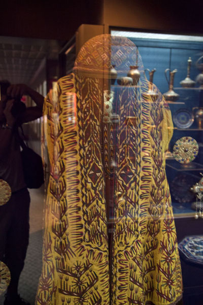 Picture of Turkoman dress with reflection of silverware showcase