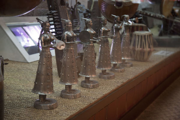 Row of statues with musical instruments | Tareq Rajab Museum | Kuwait