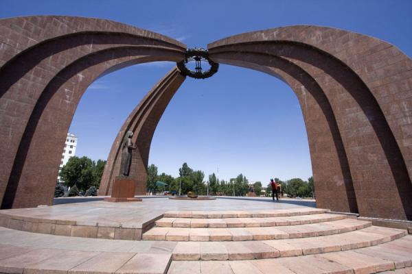 Arches of the granite yurt and statue together make up the Victory Monument | Victory Monument | Kyrgyzstan