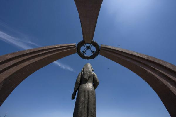 Looking up the statue, wreath, and three ribs representing a yurt | Victory Monument | Kyrgyzstan