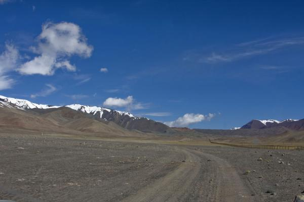 Road in a wide valley leading up to Kyzyl-Art pass | Kyzyl-Art border crossing | Kyrgyzstan