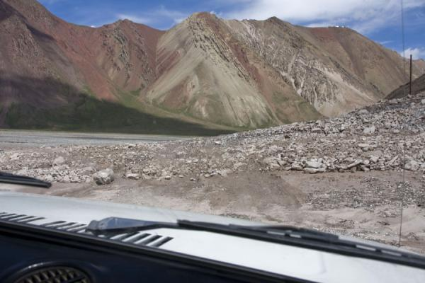 Road with obstacles: landslide over the road in no mans-land | Kyzyl-Art border crossing | Kyrgyzstan