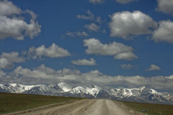 Empty road leading through the Tien Shan mountains towards Torugart | Torugart border crossing | Kyrgyzstan