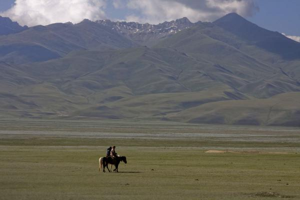 Lone horsemen in the empty landscape on the way to Torugart | Torugart border crossing | Kyrgyzstan