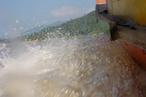Picture of Speeding up the riverFast Slow Boat - Laos