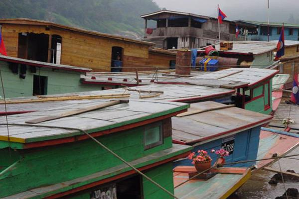 Picture of Boats docked on the river bankFast Slow Boat - Laos